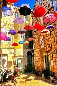 A colorful umbrella courtyard in Korcula Croatia