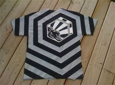Design and create tshirt with decals, electric tape and diluted bleach. Interesting fun project.
