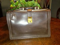 Front of a Stunning 50s small doctor bag in brown leather