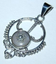 Detailed Balinese Rose Quartz Sterling Silver Pendant