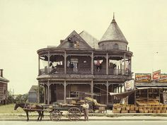 House in Houston, Texas, May FSA color photograph by John Vachon. Shows wooden Victorian style house, laundry hanging on upper gallery; in front is a horse drawn wagon. To right of photo is a fruit stand. Old Buildings, Abandoned Buildings, Abandoned Mansions, Abandoned Places, Victorian Homes, Victorian Era, Victorian Castle, Old Photos, Vintage Photos