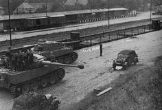 A German Kubelwagen & two Tiger tanks. Date/location unknown....