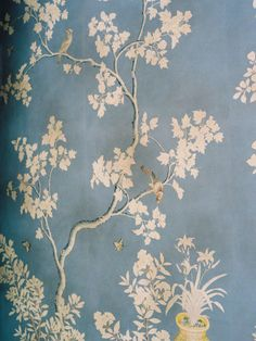 white chinoiserie on mottled blue wall, bird details