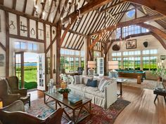 Country Living Room with Cathedral ceiling, Exposed beam, Chandelier, Bronze Swag Chandelier, Hardwood floors, Carpet