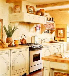 Country French Decor Style: kitchen with detailed and distressed cabinets (love the cabinets!