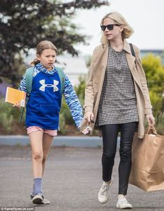 Mama knows best: Michelle Williams held her daughter Matilda Ledger's hand as they ran err...