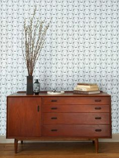 Notice this Wallpaper and dresser Totally the feel of 60s and 70s era