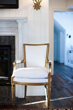 gold louis chair with cream linen.