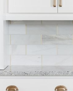 Royal Satin White Marble Subway Tile - 4 x 12 in. - The Tile Shop love the gold grout, something special for laundry. Just a little bit Marble Subway Tiles, Subway Tile Kitchen, Honed Marble, Gold Kitchen Faucet, Home Design, Küchen Design, Design Elements, The Tile Shop, Wall And Floor Tiles