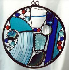 pretty - found beach glass...shells?  ornaments?