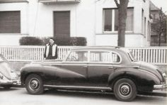 A closer look at the 1958 Mercedes 300 Elvis owned while stationed in Germany from 1958-60. Visible in front of the Mercedes is a Volkswagen Beetle of late '50s vintage that was the first car Elvis purchased in Germany. Vernon Presley is standing behind the Mercedes.