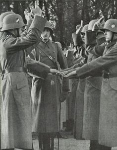 German soldiers swearing the personal oath of allegiance to Hitler introduced on 2 August 1934.
