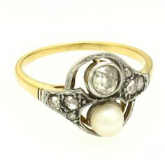1910's 18k Gold, Diamond & Pearl Ring - This 1910's ring is crafted in 18 karat yellow gold and features a total of 0.35 carat of Old Mine and rose cut diamonds all surrounding a white pearl. -                                                                                                   $695.00                                           - http://www.excaliburjewelry.com/shop/all-categories/1910-s-18k-gold-diamond-pearl-ring.html