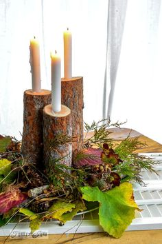 This fall centerpiece with rustic wood candles is DEF happing in my house---how cute is this?!