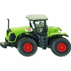 """Siku Claas Xerion #1421 by Siku. $8.99. Length: 2 7/8"""". Height: 1 1/2"""". Width: 1 1/2"""". The most powerful and largest tractor to miniature scale. High end lettering and original detailing production combined with a low price will inspire parents and kids who are agricultural experts."""