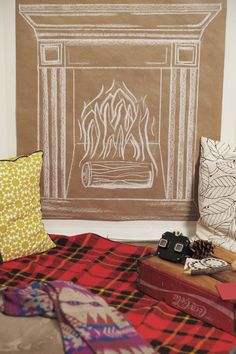 Hang a painting/drawing of a fireplace on your wall.