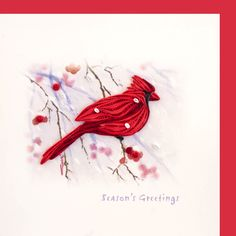 "Quilled ""Season's Greetings"" card featuring red cardinal on front"
