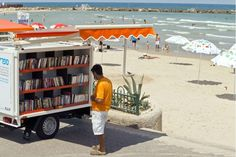 Tel Aviv.   A mobile library ON the beach...Double Like!!