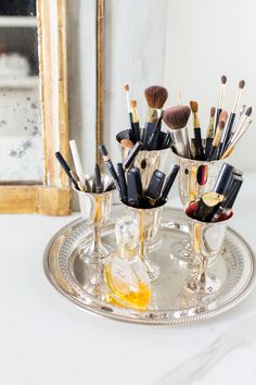 Storing Make Up Supplies in Silver Cups and Displayed on a Silver Tray | ©AlyssaRosenheck2015