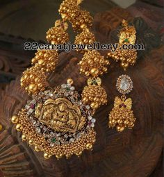 22 carat gold jhumkas hanging long chain with small gold round solid balls hanging throughout the bottom of the jhumkas. Adorable antique...