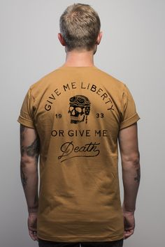"""100% Made in America  A battle cry of liberty.Made of 100% fine ring-spun combed cotton, this  lightweight fine tee is exceptionally smooth and tight-knit, giving it a  perfect vintage feel that gets better with time.  Model is 5' 10"""" wearing a size Medium."""