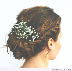Lovely wedding updo with flowers