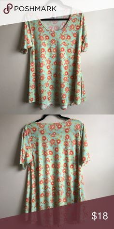 LuLaRoe Perfect Tee In excellent condition... The LuLaRoe Perfect Tee... Mint blue-green background with a orange-coral floral print LuLaRoe Tops Tees - Short Sleeve