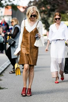 Sienna Miller - Brown leather slip dress + mules + yellow purse + white shirt ruffles