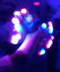 """This is the photo I will use for my hand. I took this image at Thomas Gold at LitUltrabar in January.  This is my friend Trav.  He does this thing called """"gloving.""""  He """"gives people shows"""" and in my eyes, the finger control is pure art.  It is entrancing."""