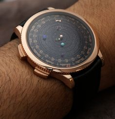 Van Cleef and Arpels Complication Poetique Midnight Planetarium Watch Hands-On. Shows the rotation of Earth & 6 nearest planets.