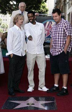 Adam Sandler, Chris Rock and David Spade looking over Chris Farley's star on the Holloywood walk of fame.