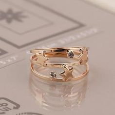 Buy 'Love Generation – Star Layered Ring' with Free International Shipping at YesStyle.com. Browse and shop for thousands of Asian fashion items from China and more!