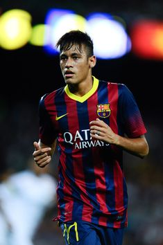 Neymar of FC Barcelona looks on during a friendly match between FC Barcelona and Santos at Nou Camp on August 2, 2013 in Barcelona, Spain.