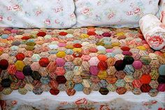 Beekeeper's Quilt.  It's little stuffed hexagons knit from sock yarn and sewn together quilt-style.  Brilliant!!!