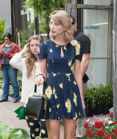 Taylor Swift Puts on the Retro-Girly Hat for Earth Day |  $113 BUY ➜ http://shoespost.com/taylor-swift-green-mary-jane-bow-earth-day-floral-dress/ Retro is in Taylor Swift's blood. It's in her veins. No one, absolutely no one, can take it out of her system. Not even her. It's in her DNA. I thought Taylor was done with her squeaky clean retro-girly image, but boy was I wrong. During Earth Day this week (April 22), the country cutie chann...