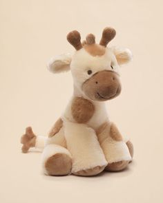 Help your child fall asleep with the Gund Niffer Giraffe Musical Plush. This fun plush is soft and cuddly and plays a calming lullaby when wound up. Giraffe Stuffed Animal, Baby Stuffed Animals, Giraffe Toy, Pet Toys, Baby Toys, Kids Toys, Newborn Toys, Baby Baby, Plush Animals