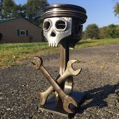 A personal favorite from my Etsy shop https://www.etsy.com/listing/560868189/piston-skull-and-crossbones-welded-scrap