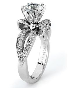 True Knots; Style - True Woman. Shown in platinum, this engagement ring sparkles with 0.51 cttw of round diamonds.