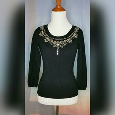 """JEWELED EMBELLISHED SWEATER Size PP/XS. Black. Beautiful embellished neckline. No gems are missing. Long sleeve. Thick knit. Like new. No tears or stains. 64% Rayon/36% Nylon. Length: 20"""". True to size. Nine West Sweaters Crew & Scoop Necks"""
