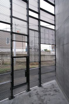 031_08_Nagaizumi. Powder coated perforated steel screen.