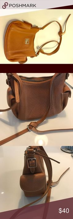 Dooney & Bourke brown leather purse. Dooney & Bourke brown leather purse. Barely used. Dooney & Bourke Bags Shoulder Bags