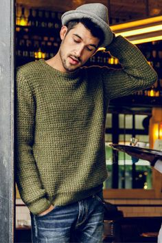 Details: • O-neck • Knitted • Ribbed cuffs and bottom • Slim fit • Color: Olive Fabric & Care: • 5% Mohair, 10% Wool, 30% Nylon, 55% Acrylic • Dry clean • Imported