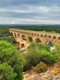 Pont du Gard, France -- LOVED it! It is equally as beautiful in person ... even in the rain from under a shelter!