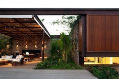 [Exterior terrace with pergolas and vegetation]