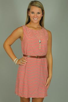 FIRE ME UP DRESS...Stripes are totally in this season, and every other season for that matter:) With its classic shape and pattern, you really can't go wrong with this dress! The thin red and white stripes are nautical and perfect for summer! The gold button & keyhole opening in the back adds the perfect amount of detail. This dress comes with the belt shown in the picture! The fabric is lightweight and opaque, so you don't need a slip!
