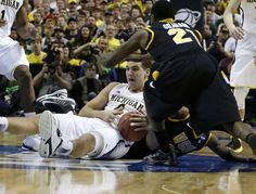 Michigan's Mitch McGary gets to a loose ball in the first half against Virginia Commonwealth in Third round of the NCAA tournament in Auburn Hills, MI. on Saturday March 23, 2013.