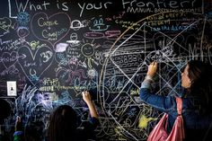 BLACKBOARD INSPIRATION: Fair attendees participate at the World Maker Faire, a two-day celebration of do-it-yourself innovations in science ...