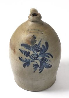 Sold $ 1,000 Four-gallon stoneware jug, 19th c., impressed Cowden & Wilcox Harrisburg Pa, with cobalt floral decoration, 15 1/2'' h.