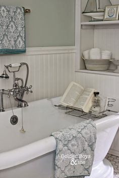 Pedestal tub with vintage style faucet and over the tub rack in DIY master bathroom