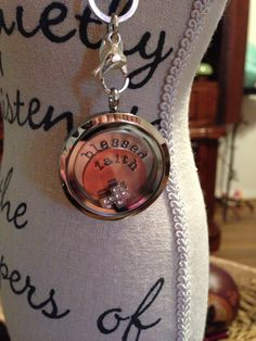 Origami owl locket This locket, as pictured with a medium silver locket, a medium 'blessed' plate, a mini 'faith' plate and a cross charm
